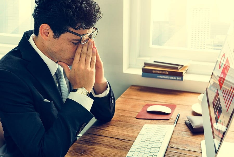 an image of an IT professional frustrated with an ERP project