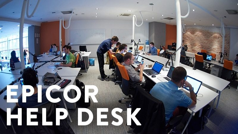 an image of encompass solutions managed services providers at their desks helping Epicor customers.