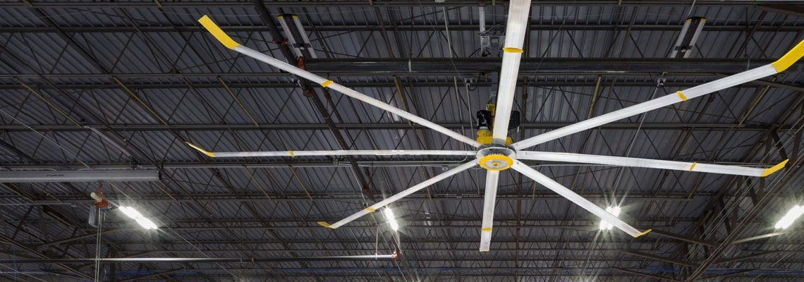 an image of a big ass solutions fan in a warehouse