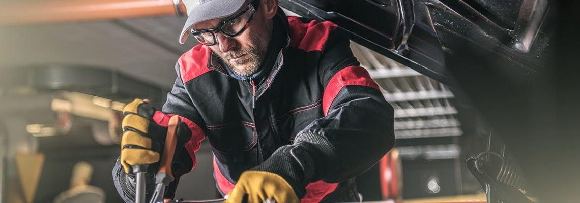 an image of a mechanic working on service shop efficiency