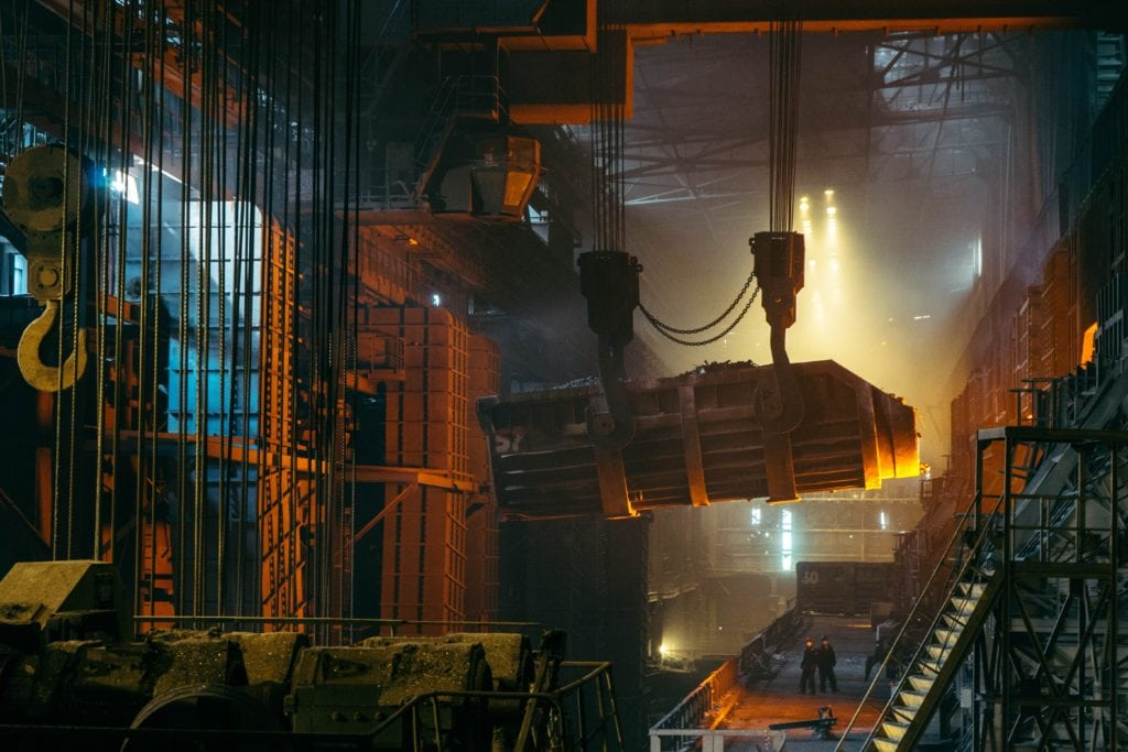 A picture of workers and equipment in a manufacturing facility