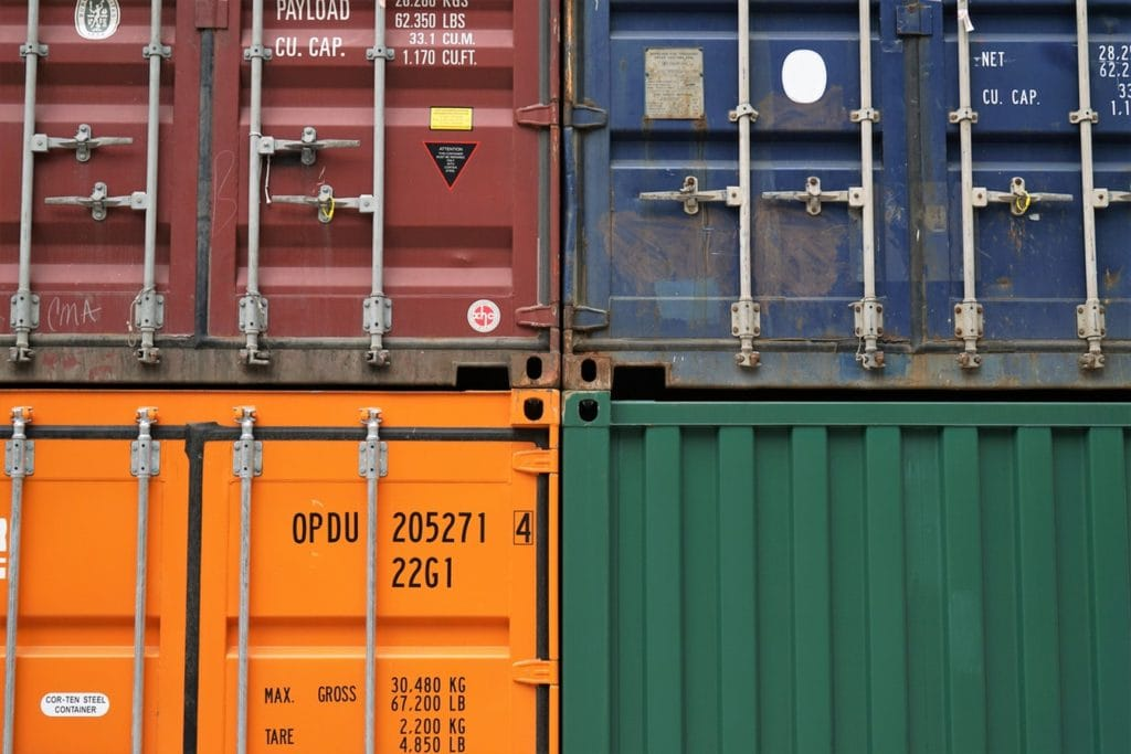 An image shipping containers ready to deliver food and beverages.