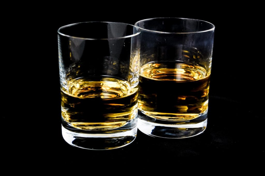 a picture of two glasses of whiskey, neat.
