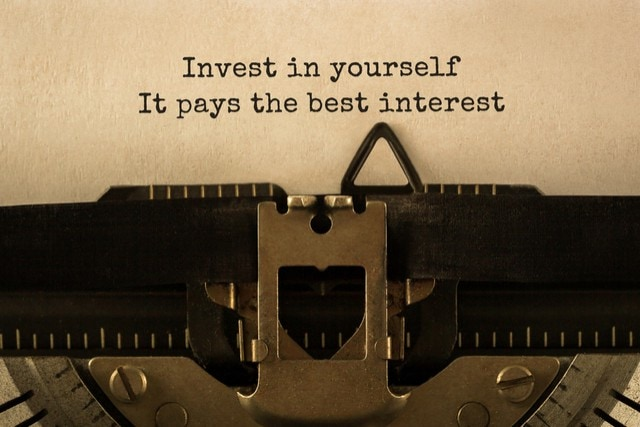 "a photo of a typewriter with the words ""Invest In Yourself It Pays The Best Interest"" typed on a sheet of paper."