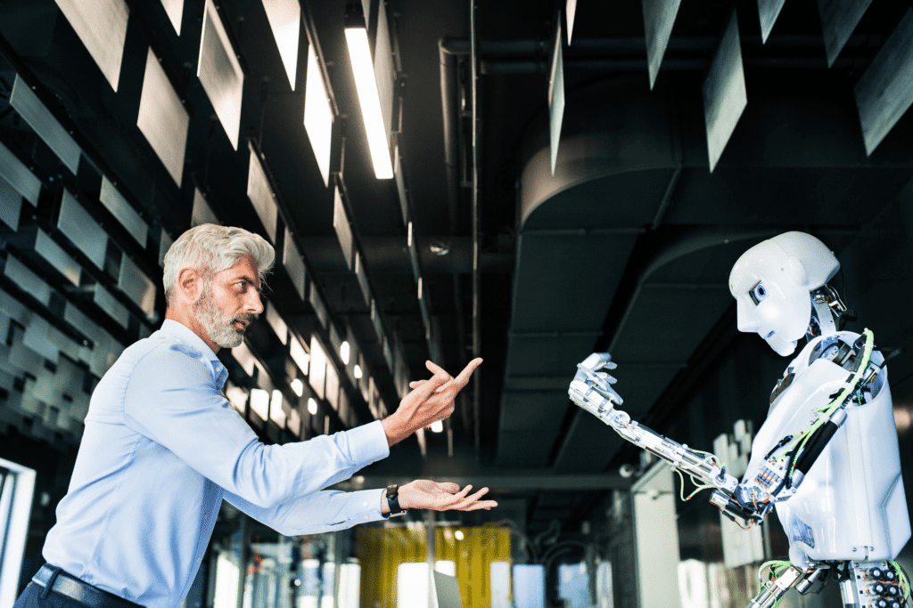 A photograph of a Chief Robotics Officer commanding a humanoid robot