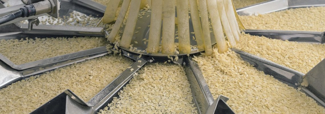 a photo of grain sorting machinery in a food processing plant. - encompass solutions.