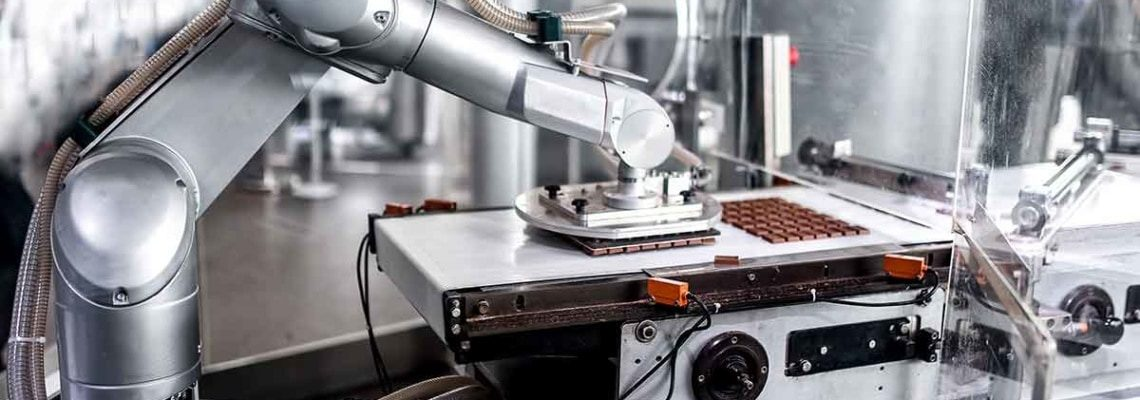 a photo of a robot in a chocolate processing facility