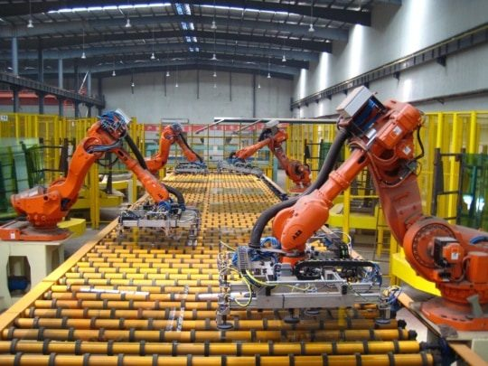an image of fixed (hard) automation in manufacturing on the factory floor