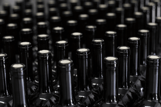 An image of filling and corking wine bottles to specification, a task food and beverage manufacturing ai can make easier.