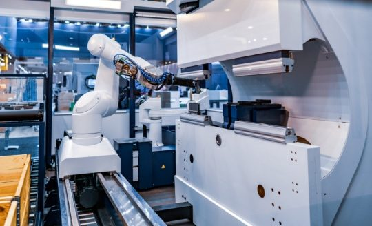 an image of robotic arm automated production in industrial automation