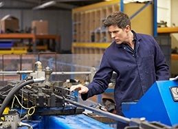 an image of an engineer at a hydraulic pipe bender using epicor prophet 21 erp for distributors