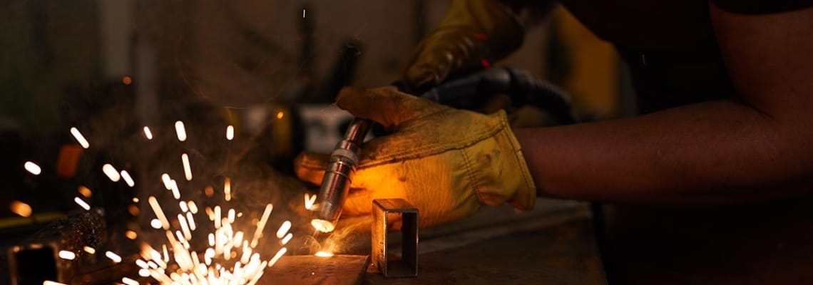 an image of a welder at work as part of the US skilled labor shortage in manufacturing