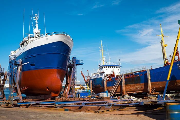 an image of ship in dry dock as a way to Leverage Downtime To Improve Core Systems And Processes. A reference to encompass virtual and remote consulting services