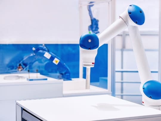 an image of a robot in a smart factory as part of advanced manufacturing technology