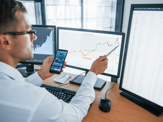 an image of a business person using business intelligence and analytics software, like Epicor data analytics (EDA) for Epicor ERP