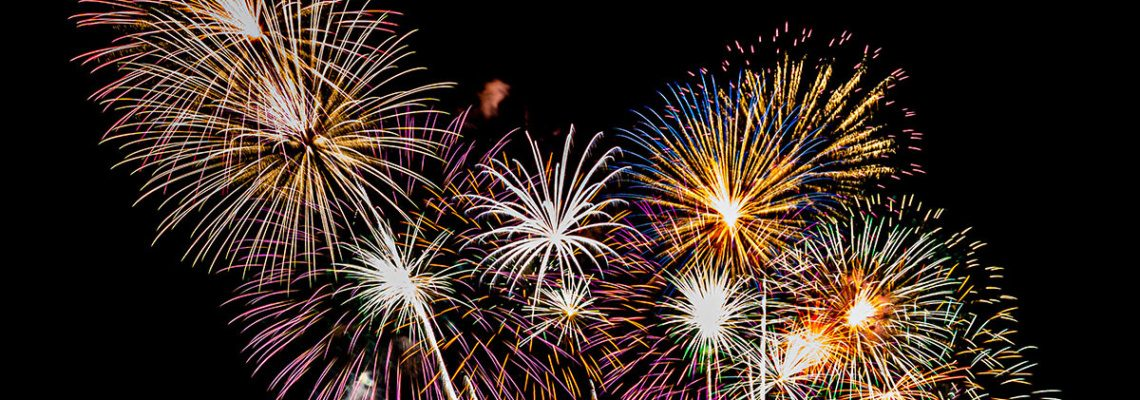 an image of encompass solutions 20th anniversary celebration with a fireworks display